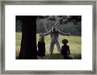 A Rabbit Meets Two Children During An Framed Print by Joel Sartore