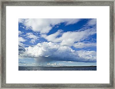 A Rain Storm Pours Framed Print by Jason Edwards