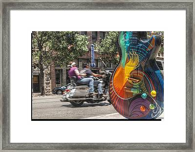 A Rainbow Guitar On Congress In Austin Framed Print by Jennifer Holcombe