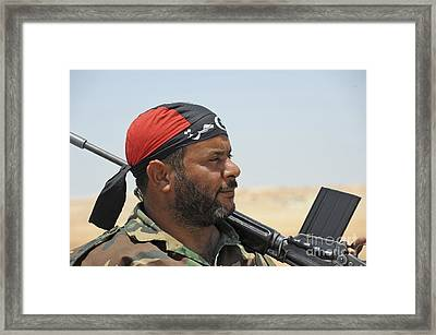 A Rebel Fighter Armed With A Fn Fal Framed Print by Andrew Chittock
