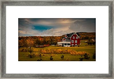 A Red Farmhouse In A Fallscape Framed Print