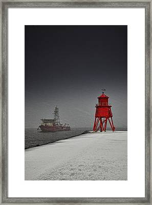 A Red Lighthouse Along The Coast In Framed Print by John Short
