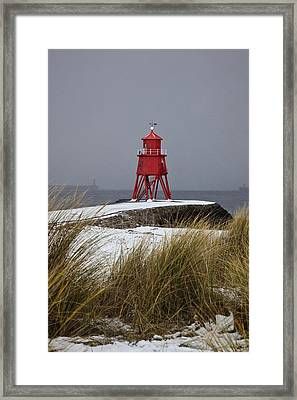 A Red Lighthouse Along The Coast South Framed Print by John Short