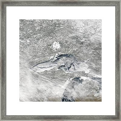 A Relatively Rare Blanket Of Ice Rests Framed Print by Stocktrek Images