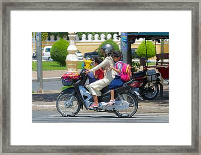 A Ride To School. Framed Print by David Freuthal
