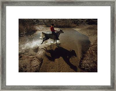 A Rider Retraces The Original Pony Framed Print by Phil Schermeister
