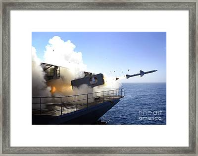 A Rim-7 Sea Sparrow Missile Launches Framed Print by Stocktrek Images