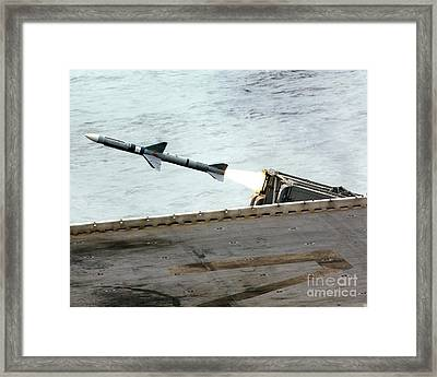 A Rim-7m Sea Sparrow Missile Is Fired Framed Print by Stocktrek Images