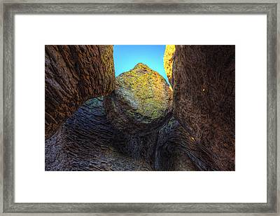 A Rock Balanced Precariously Framed Print by Robert Postma