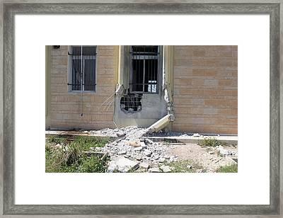 A Rocket Propelled Grenade Damaged This Framed Print by Stocktrek Images