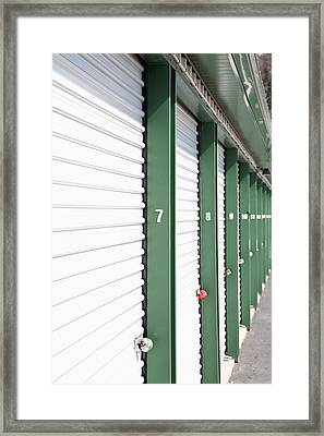 A Row Of Locked Storage Units At A Self Storage Facility Framed Print