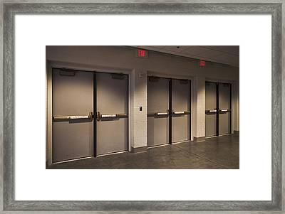 A Row Of Three Emergency Exits Framed Print
