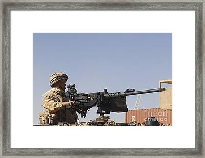 A Royal Marine Manning A .50 Caliber Framed Print by Andrew Chittock