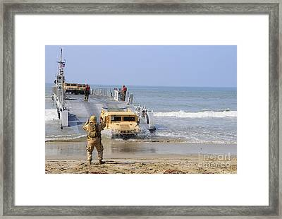 A Sailor Directs A Humvee Framed Print