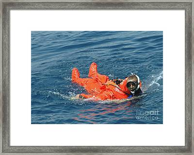 A Sailor Rescued By A Diver Framed Print by Stocktrek Images