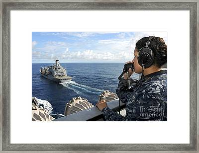A Sailor Stands Forward Lookout Watch Framed Print by Stocktrek Images