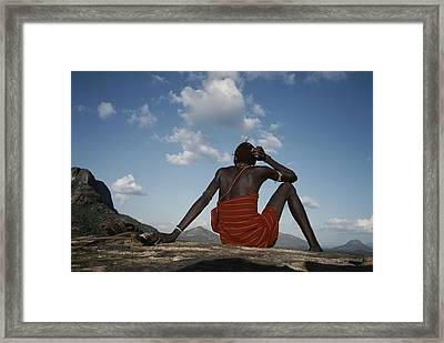 A Samburu Goatherd Takes A Break Framed Print by Bobby Model