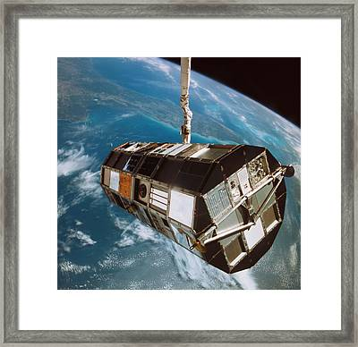 A Satellite Above The Earth Framed Print by Stockbyte