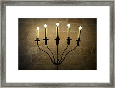 A Sconce With Illuminated Electric Candles Framed Print
