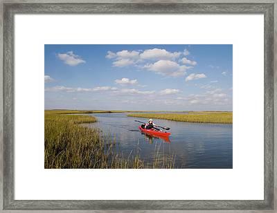 A Sea Kayaker And Fisherman Paddles Framed Print by Skip Brown