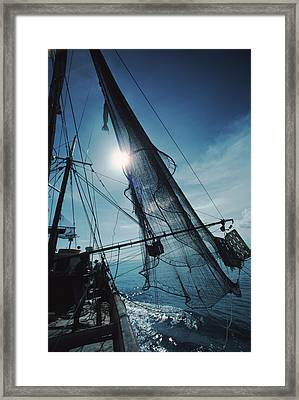 A Shrimping Boat Off The Coast Framed Print
