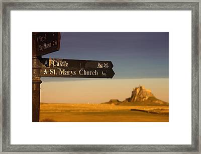 A Sign Post Pointing To A Castle And Framed Print