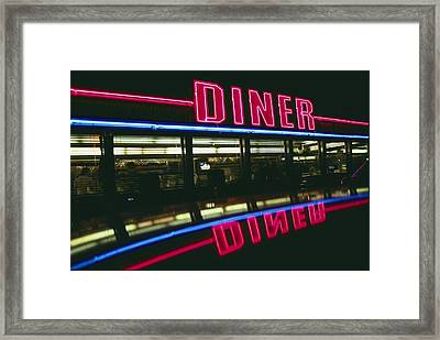 A Sign Relects Off A Car Roof Framed Print by Stephen St. John