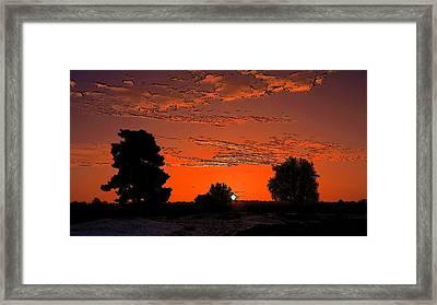 A Silent Sun Framed Print by Viveka Singh