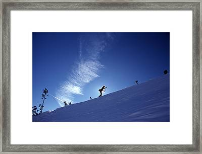 A Silhouette Of A Woman Cross Country Framed Print by Kate Thompson