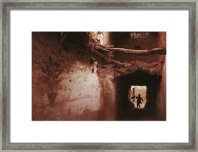 A Silhouetted Child Running Framed Print