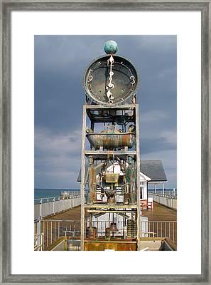 A Slightly Rude Water Clock Framed Print by Rod Jones