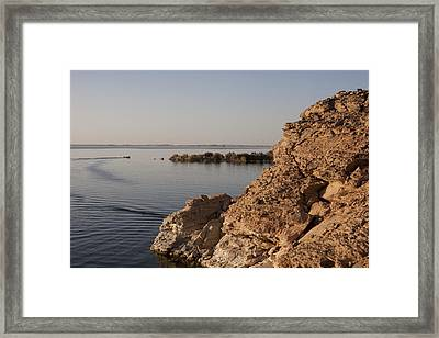 A Small Boat Floats Through Lake Framed Print by Taylor S. Kennedy