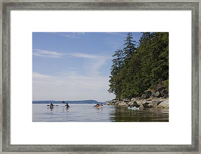 A Small Group Of People Kayak Framed Print by Taylor S. Kennedy
