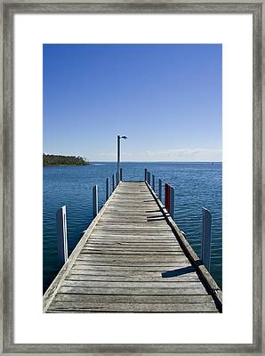 A Small Jetty In A Sheltered Framed Print by Jason Edwards