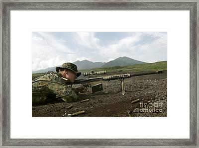 A Sniper Fires A M82a3 .50-caliber Framed Print by Stocktrek Images