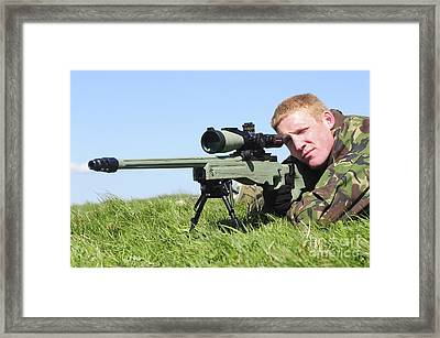 A Sniper Looks Through The Sight Framed Print by Andrew Chittock