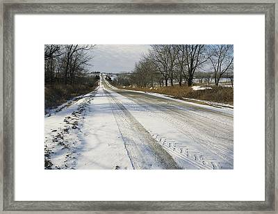 A Snow-covered Road Passes Framed Print by Joel Sartore