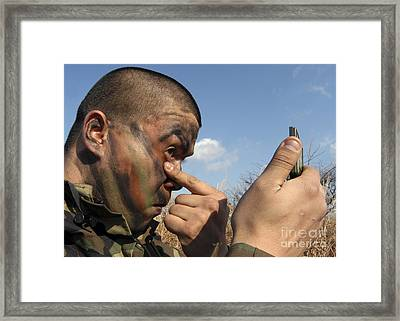 A Soldier Applying Face Paint Prior Framed Print by Stocktrek Images
