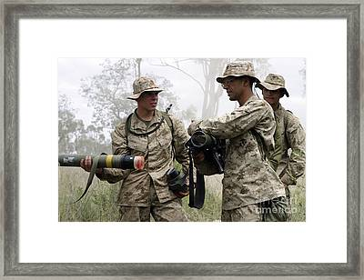 A Soldier Assists A Mortarman Framed Print by Stocktrek Images