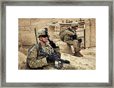 A Soldier Calls In Description Framed Print by Stocktrek Images