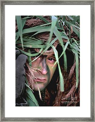 A Soldier Camouflaged In His Ghillie Framed Print by Stocktrek Images