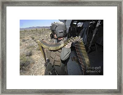 A Soldier Carries .50 Caliber Machine Framed Print