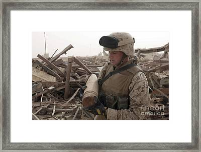 A Soldier Carries An Unused 155 Framed Print