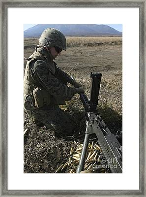 A Soldier Changes The Barrel Of An M2 Framed Print by Stocktrek Images