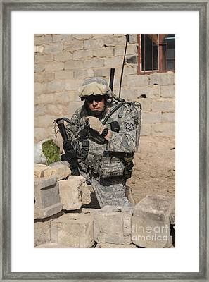 A Soldier Communicates His Location Framed Print