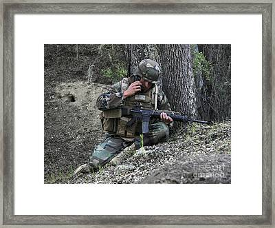 A Soldier Communicates His Position Framed Print