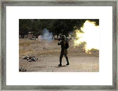 A Soldier Fires A M136 At-4 Rocket Framed Print by Stocktrek Images