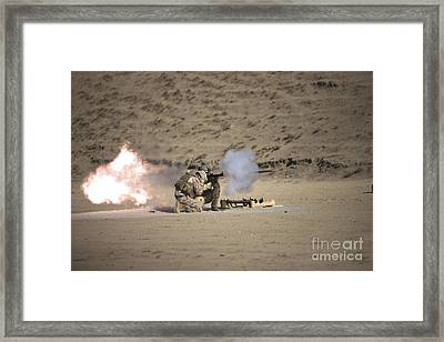 A Soldier Fires A Rocket-propelled Framed Print