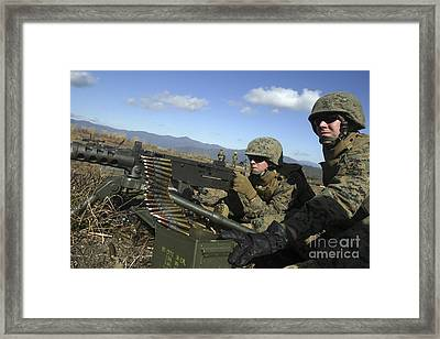 A Soldier Fires An M2 .50 Caliber Framed Print