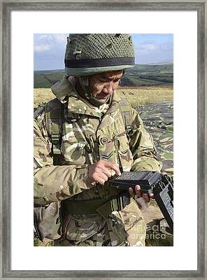 A Soldier Inputs The Firing Data Framed Print by Andrew Chittock